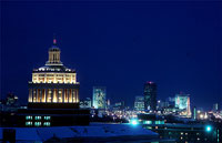 Rush Rhees' distinctive dome and Rochester's skyline at night